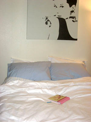 Audrey Hepburn above the bed