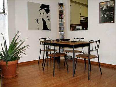 Black and white Audrey Hepburn in dining room