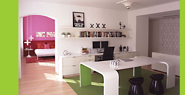 Office space with black and white accents with deep pink and lime green accents