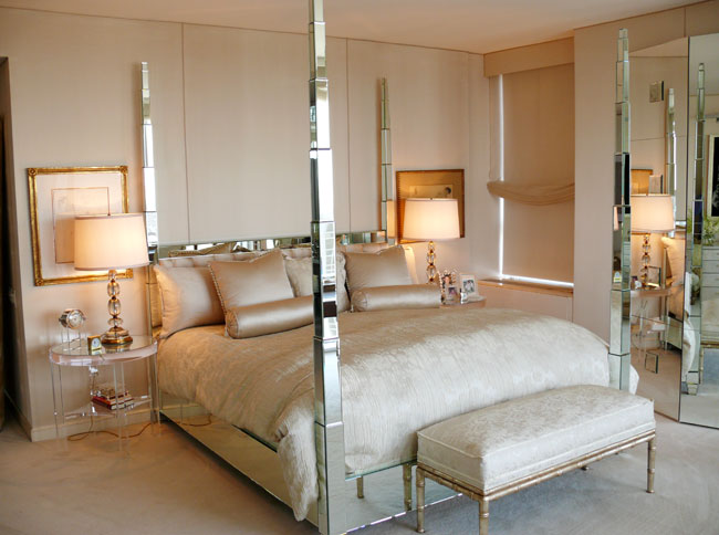 Nancy Corzine's bedroom with glamourous mirrored 4 poster bed