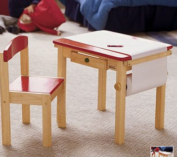 Cute red kids table with roll of paper attached
