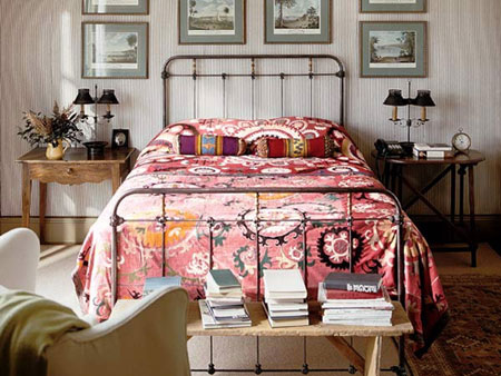 Asymmetry in side tables but table lamp heights and artwork are symmetrical