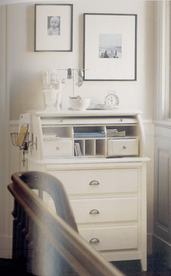 White bureau as storage for foyer