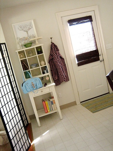 Small table with pigeonholes to create small foyer storage