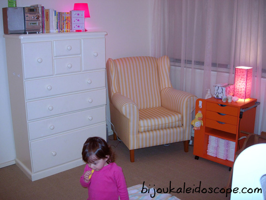 Hannah's room with dresser, yellow armchair and orange IKEA cabinet