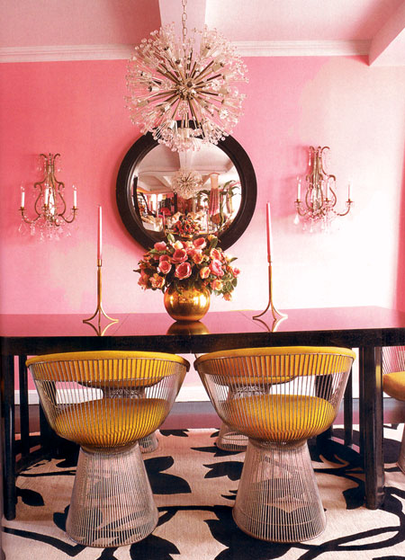 Betsey Johnson's dining room in pinks and pinks and mustard dining chairs