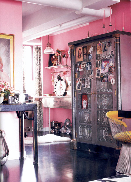 Betsey Johnson's dining room in pinks and pinks and industrial cabinet