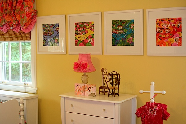 The Tolman's happy nursery for their two adopted girls. Triptypch prints