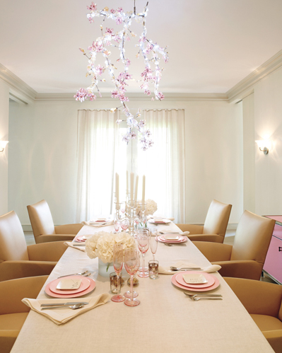 Gywneth Paltrow's dining table with Swarosvki chandelier and honey leather dining chairs