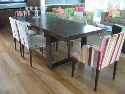 Modern dining table with different chairs