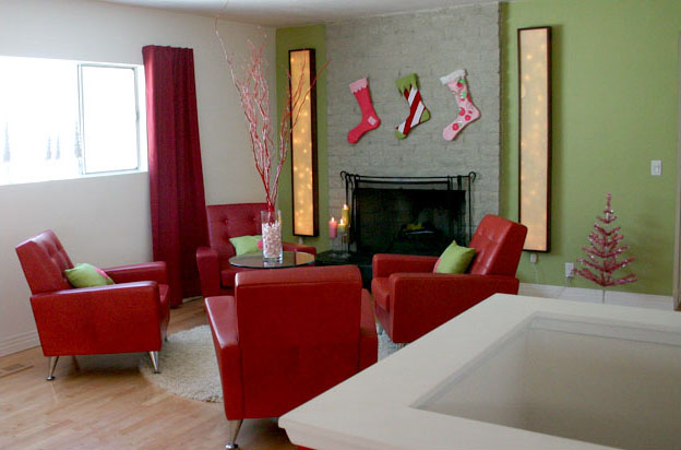 A bright red lounge in a pale green space by Kristan Cunningham