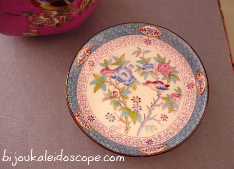 A blue pink pin dish with birds