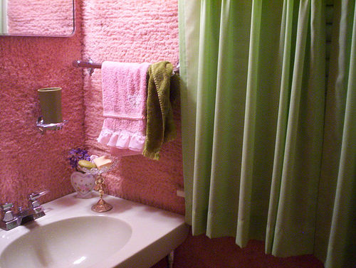 Pink carpet all over the bathroom