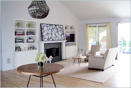 Large picture of pebbles in a white living room