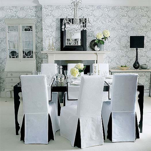Collection of crystal glasses in a black and white dining room