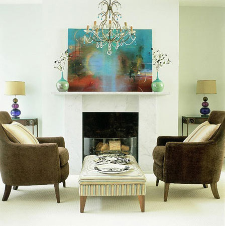 Bluish painting in a white fireplace