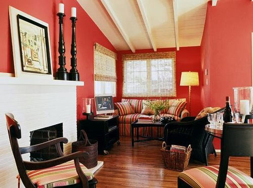 Painting above fireplace in a salmon living room