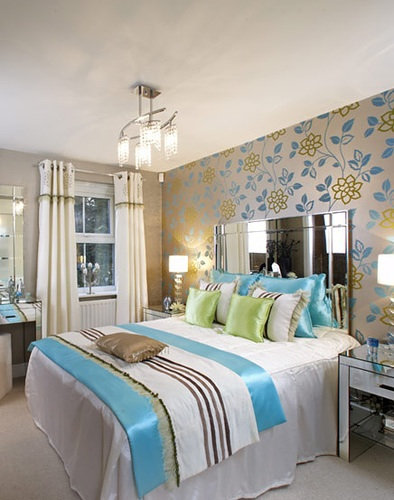 Serene bedroom in golds, blues and greens, via from Design for All Occasions.