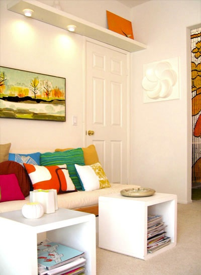 White living room with happy coloured cushions