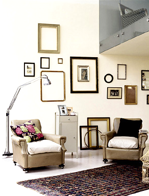 Collection of vintage empty frames on a white, tall wall, via Louisa Grey from Loop Management