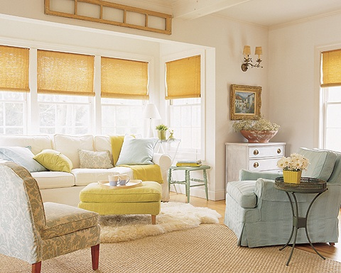 Beautiful white living room with yellows, blues and greans