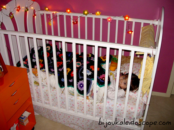 Hannah still in her cot at this stage, enjoying the warm glow of lights + new walls