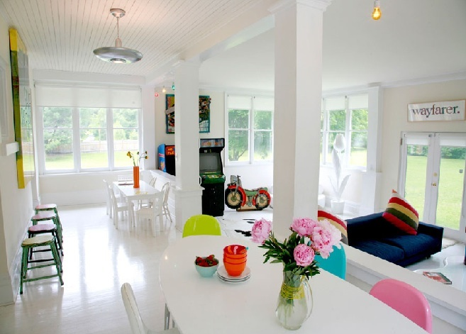 Funky colourful space in an all white living room + kitchen shot