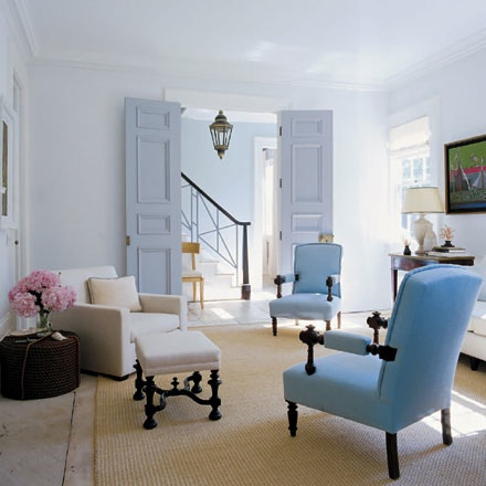 Light blue chairs in white room with pink accents, via Elle Decor