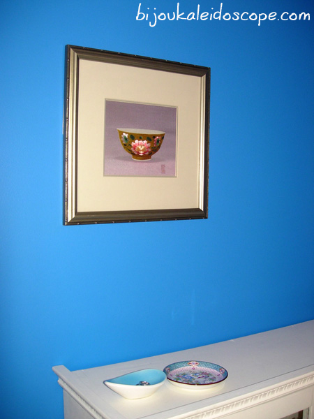 Love how this art piece colours are brought out by the strong blue colour in our master bedroom
