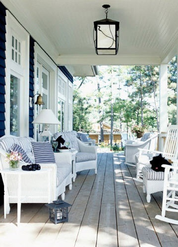 Beautiful outdoor porch and courtyard area in white wicker and deep blues Stacey Brandford
