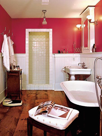 One of my favourite bathrooms, in deep pink and white along with wide wooden floor boards.