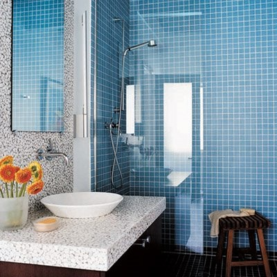 I love this blue tiled bathroom with the sleek stool for essential grooming