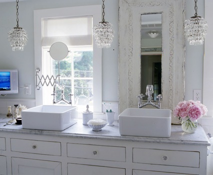 Two sinks in an all-white bathroom