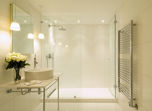 Super minimal bathroom with glass wall dividing shower area and rest of bathroom, via Philippe Starck.