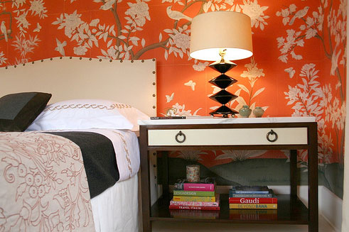 Bedside drawers in orange and white bedroom designed by Sara Story Designs