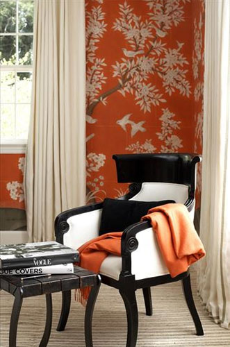 Black chair in orange and white bedroom designed by Sara Story Designs