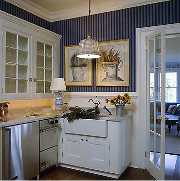 A deep blue and white kitchen and laundry corner, via Sherrill Canet Interiors.