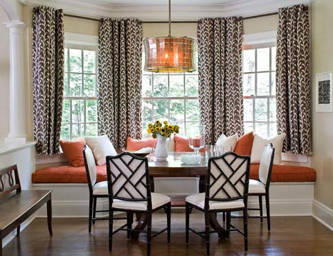 A eating nook with Chinese chippendale chairs and pumpkin accents, via Sherrill Canet Interiors.