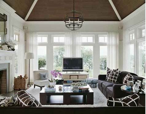 A white living room with chocolate ceiling, via Sherrill Canet Interiors.