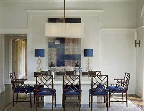 A white dining room with deep blue Chinese Chippendale chairs, via Sherrill Canet Interiors.