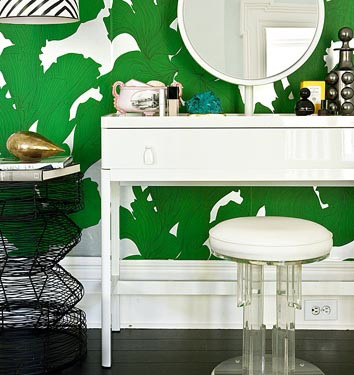 Green and white wallpaper vanity area, via Domino Mag