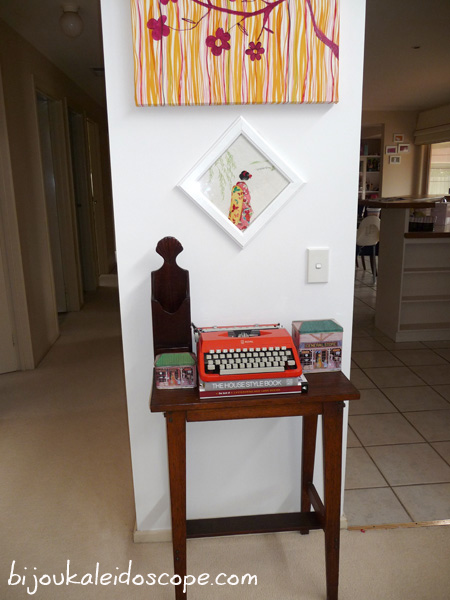 My orange Litton typewriter in its place on my new old side table