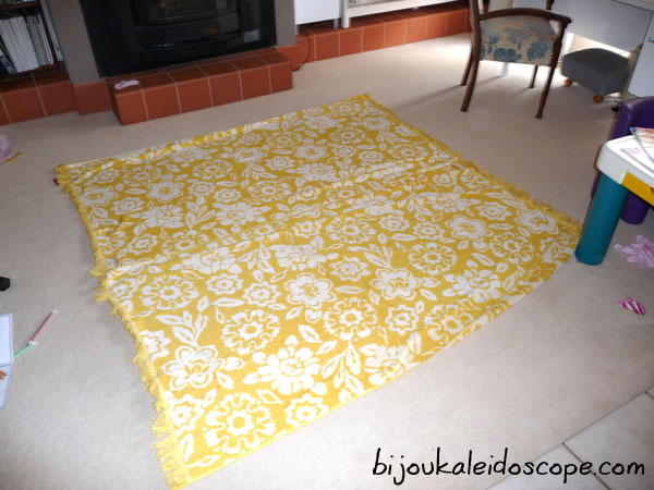 My yellow and white towels laid on our family room floor. Looks good but doesn't stay!