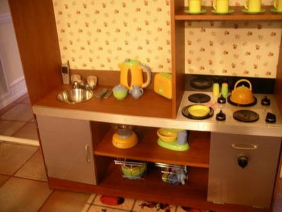 A toy kitchen from  TV cabinet from Crumb Catchers.