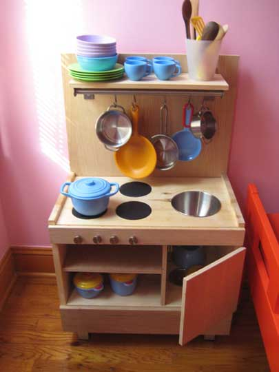 Virginia with her super cute toy kitchen, via OhDeeDoh.