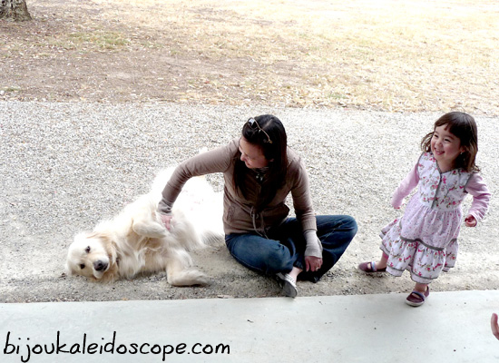 Hannah and her aunt playing with a golden retriever