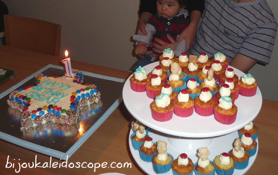 The beautiful petit cupcakes and birthday cake for the birthday boy, all in reds and blues