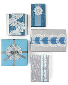 Doilys during Christmas makes snowflakes patterns on plain gift wrapping, via Martha Stewart