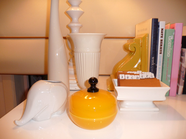 My white Wedgwood vase, white retro elephant planter with my yellow corbel bookends and my favourite yellow art glass bowl and lid