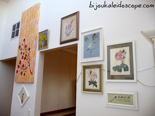My slowly growing collection of floral artwork on our large tall wall.
